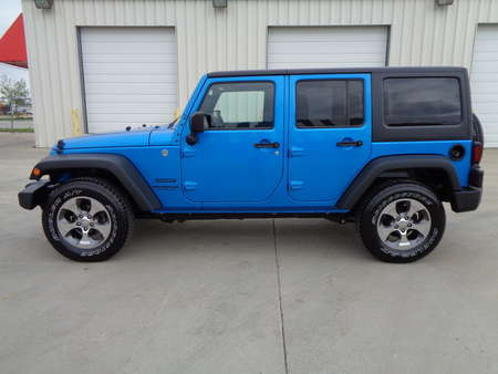 2015 Jeep Wrangler Unlimited Sport.  Bright Blue  Sahara Wheels and Tires. Auto for Sale  - 75966  - Auto Drive Inc.